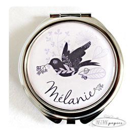 Miroir silhouette d'oiseau noir et motif floral mauve parme