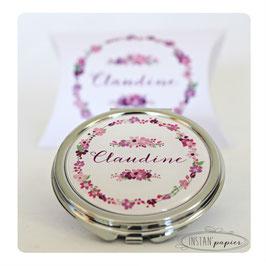 Miroir couronne de fleurs aux tonalités rose, mauve et violet