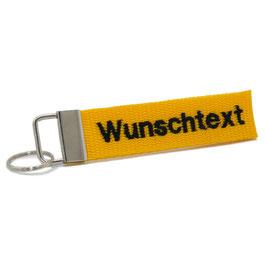 """Schlüsselanhänger gelb, beidseitig bestickt - """"Wunschtext"""""""