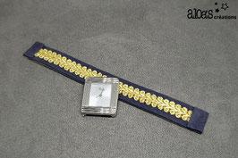 Bracelet lanière bleu marine rehaussé d'un galon or