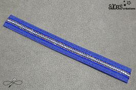 Bracelet lanière tissu bleu rehaussé d'un galon à paillettes or