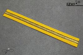 Bracelet lanière tissu jaune rehaussé d'un galon à paillettes or