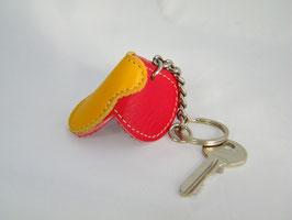 """Porte-clés """"selle"""" jaune et rouge"""