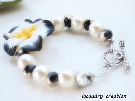 Bracelet élégant Tipanié noir et blanc , cérémonie, mariage  fleur hibiscus,