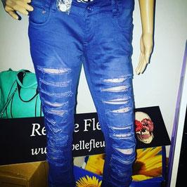 Pantaloni Blu con strappi.