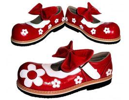 Guillermina: Moño rojo y flores blancas