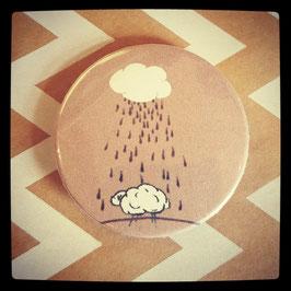 Petit badge Un mouton qui rencontre la pluie....