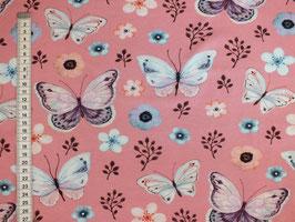 Jerseystoff mit Schmetterlingen und Blüten