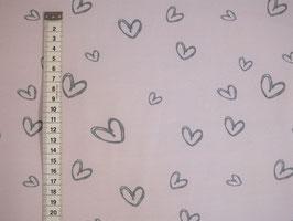 Rosa Jersey-Kinderstoff mit grauen Herzen