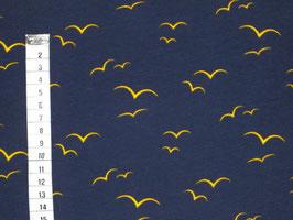 Jerseystoff mit gelben fliegenden Vögeln  in  Ökotex 100 Qualität