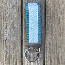 Webband-Schlüsselanhänger Ornamente auf türkis
