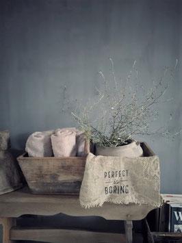 Oude graanbak met handvat