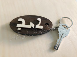 Personalized name keychain with walnut wood.