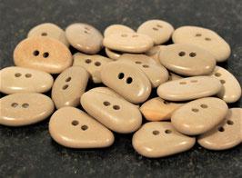Steinknöpfe aus Kieselsteinen