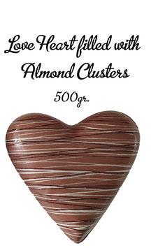 Surprise a friend - Love heart, milk, XL filled with Aldmond Clusters
