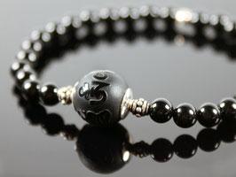 Tibetperle aus Onyx mit OM Symbol
