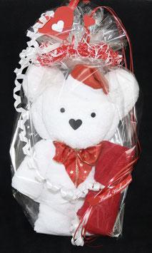 """Bär als Handtuch-Figur"""" plus gerolltem Gästehandtuch in weihnachtlich gestalteter Geschenkverpackung, weiß mit rot"""