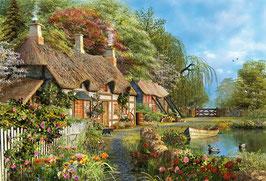 Bloemrijk huisje aan de rand van het water  (puzzel 4000 stuks)