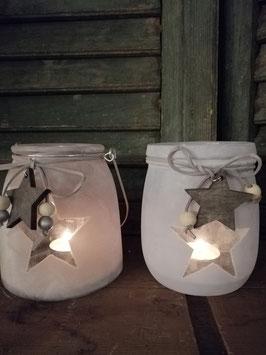 Mooi windlicht van frosted glas, met sterren, in grijs of ijsblauw, afmetingen 13 x 12 cm zonder hengsel, prijs per stuk.