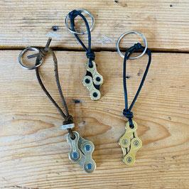 Sleutelhanger met 4 gouden fietsketting schakels
