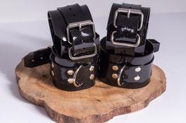 XXL Hand und Fußfesseln aus schwarzem PVC