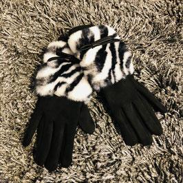 Handschuhe schwarz-weiß mit Zebra-Print auf Kunstfell