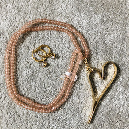 Rosa farbene lange Kette mit goldenem Herz-Anhänger