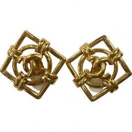 Boucles d'oreilles Chanel clips en métal doré