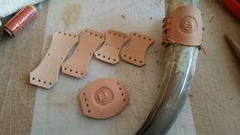 Hornhalter und Lederpatche