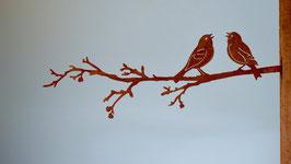 Uccellini innamorati su ramo