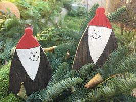Fröhliche Weihnachtsmänner aus Altholz
