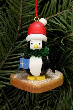 Pinguin auf Lebkuchenherz