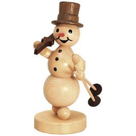 Schneemann mit Ski auf Schulter