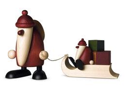 Weihnachtsmann mit Geschenkeschlitten und Kind
