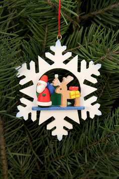 Schneeflocke  Weihnachtsmann mit Rentier