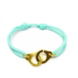Bracelet menottes anneaux dorés