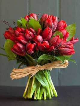 Bouquet of red tulips and berries