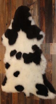 Lammfell- gescheckt (schwarz-weiß)
