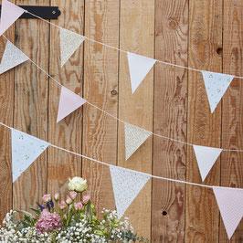 Guirlande fanions triangles imprimés fleurs et pois