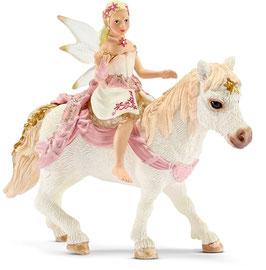 Lilienzarte Elfe auf Pony - reitend
