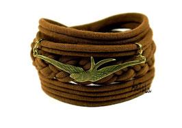 Armreifen geflochten in braun mit einer Schwalbe in bronze antik