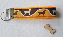 """Schlüsselanhänger """"Braunes Labrador Webband auf orangefarbenem Filz"""""""
