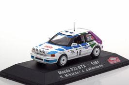 Mazda 323 GTX #10 Rally Monte Carlo 1991 H. Mikkola / J. Johansson