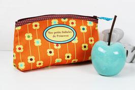 Trousse maquillage en toile orange et bordeaux motif fleuri
