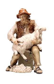Statua pastore seduto con pecora in legno