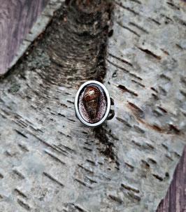 ovaler Edelstahl Ring mit echter Muschel auf lila-gold Glitzer