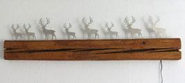Lichtleiste mit Hirsch auf Altholz