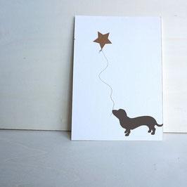 Weihnachtskarte mit stilisiertem Dackel und Sternballon
