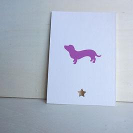 Weihnachtskarte mit stilisiertem Dackel und Sternlochung