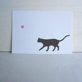 Weihnachtskarte mit seitlicher Katze und Stern